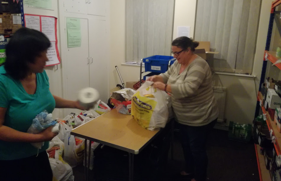 <p>Packing food parcels for clients.</p>